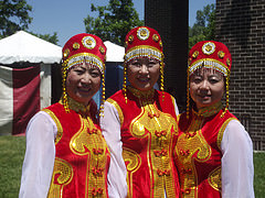 Three dancers stand together